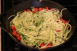 Saute zoodles with some Sarah's Farm Fresh cherry tomatoes
