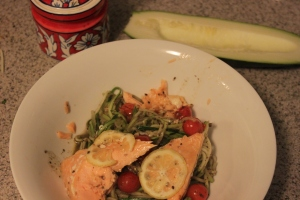 Stir in some pesto at the end of the saute and add a piece of baked salmon on top.