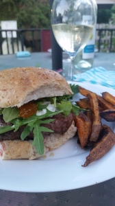 Dinner - my favorite burger!  Lamb burgers with goat cheese, arugula and peach preserves.  Served with a greek salad and sweet potato fries.